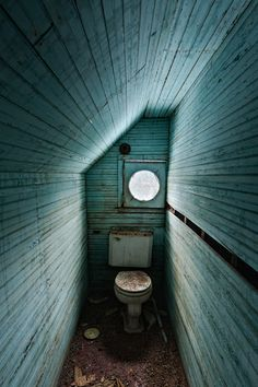 Odd-shaped bathroom in the top floor of an abandoned Catskills resort near Monticello, New York.
