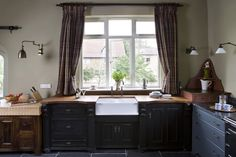 Front of the class! The classic sink unit, combined with ornate mouldings and a mixture of complementing finishes frames this bespoke kitchen and draws the eye to this large feature window.