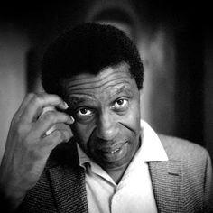 Il fait ses études secondaires à Port-au-Prince, puis devient chroniqueur culturel à l'hebdomadaire Le Petit Samedi Soir et à Radio Haïti-Inter. Le 1er juin 1976, son ami journaliste Gasner Raymond, alors âgé de vingt-trois ans comme lui, est assassiné par les Tontons Macoute. À la suite de cet événement, craignant d'être « sur la liste », il quitte de manière précipitée Haïti pour Montréal, n'informant personne, à l'exception de sa mère, de son départ.