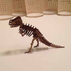 This is a cardboard puzzle kit. The size of the trex is 64 times smaller than reality. Dinosaur Puzzles, Popular Toys, Funny Toys, Unique Toys, Cool Toys, Vintage Toys, Unique Jewelry, Handmade Gifts, Conference