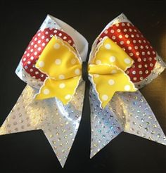 """Minnie Loves Dots"" Disney Minnie Mouse Cheer Bow, shown in 3 inch with pointed tails."