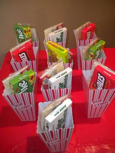 individual popcorn containers containing candy and microwave popcorn for each girl. Movie marathon party