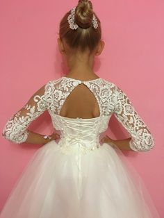 Please read our store policies before placing your order here https://www.etsy.com/ru/shop/Butterflydressua/policy Beautiful white or ivory flower girl dress with multilayered skirt, corset with lace applique, zipper and lacing. Item material: upper layer of the skirt- tulle with lace applique middle layer of the skirt- tulle lower layer of the skirt- taffeta corset- satin with lace applique Dress color: ivory white Color of the sash: ivory blush pink re...