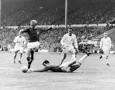 May Manchester United inside forward Denis Law is first to react when Leicester City goalkeeper Gordon Banks fails to hold on to the ball, in the FA Cup Final. Manchester United Images, Manchester United Players, Leeds United, Liverpool Images, Oxford United, Barcelona Soccer, Fc Barcelona