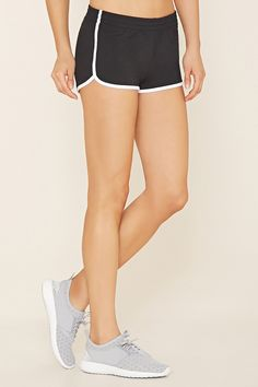 A pair of knit shorts with contrast trim, a dolphin hem, and an elasticized waist.