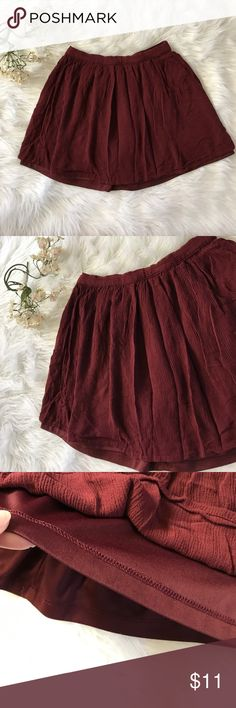 Forever 21 flared mini skirt This cute skirt has a Maroon skirt has a elastic waistband and has an attached lining Forever 21 Skirts Mini
