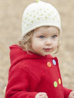 Baby hooded jacket knitting pattern in the Rooster Village Living pattern book- get it at Laughing Hens