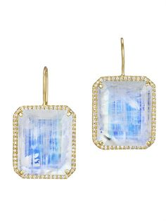 Icy rainbow moonstones are the centerpiece of these earrings from Lauren K, which are subtly decorated with a contrasting border of 18k yellow gold and lined with diamonds.