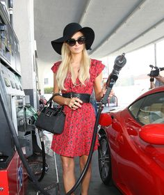 """Paris Hilton March 15, 2012 : Pumping her own gas while out shopping. The heiress even Tweeted about her fun time out: """"Great day. Girl's luncheon at The Ivy with @Nicky Hilton & friends. Then shopping at Chanel and Alice & Olivia."""" http://celebhotspots.com/hotspot/?hotspotid=6317&next=1"""