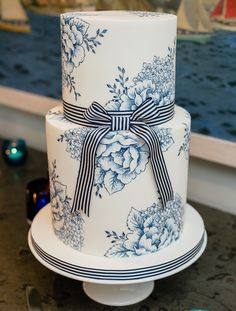 NAUTICAL STRIPES AND FLOWERS A delicate hand painted design in blue and white enhanced by a bold striped ribbon. This design is a favorite for nautical themed weddings and can be recreated over any number of tiers. Wedding Cake Designs, Wedding Cakes, Wedding Ideas, Painted Wedding Cake, Hand Painted Cakes, Glass Cakes, Cake Tasting, Floral Cake, Cake Flavors