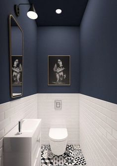 Stylish toilet with dark blue walls and white metro tiles - 35 ideas for blue wall colour in home decoration | Aliz's Wonderland #bathroomDecorating