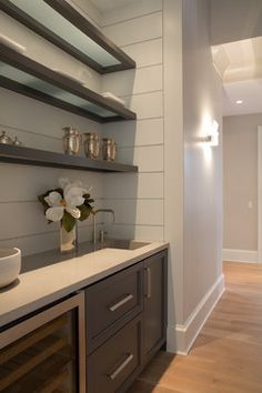Love this idea - frosted glass shelves with a dark wood frame. Possible #DIY for the bathroom...