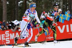 Jessie Diggins of the United States skiing with Celia Aymonier of France early on in the 30 k classic race at the 2015 FIS Nordic World Ski Championships in Falun, Sweden. Diggins later dropped out.