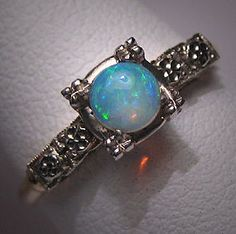 Opal - my birthstone  i want a wedding ring like this