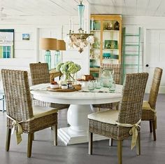 Coastal cottage decor with rattan dining room chairs... http://www.completely-coastal.com/2017/04/indoor-rattan-chairs-for-coastal-beach-decor.html