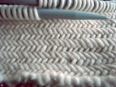 Click on the link to see a beautiful tutorial on the herringbone stitch..