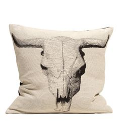 H&M Jacquard weave cow skull cushion cover.