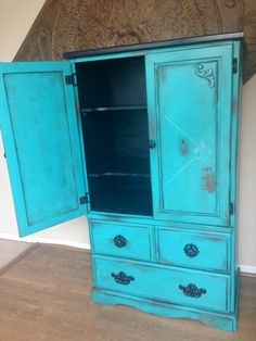 Distressed Armoire / Entertainment Center. $250.00, via Etsy.