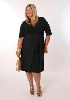 Eliza Parker's Florence Dress in Black is super versatile and figure flattering.  Wear this plus size classic wrap to weddings, bachelorette parties, or a holiday soiree.