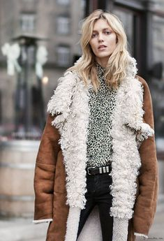 Off duty model, staying stylish in a leopard shirt and a sherling jacket.
