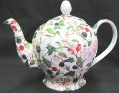 Just by looking at this design, you can tell this is special! And we will confirm it, there are limited quantities available! This beautiful hand decorated, fine bone china tea pot holds 36 ounces and even has filter holes inside the spout. They didn't decorate this with just one design, they incorporated many! AS you can see there are several shades of flowers and berries to keep the eye busy. The handle is adorned with plain white glaze, just as the lid is as well. Alone, it might be odd…
