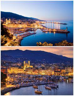 La ville de Bastia illuminée quand la nuit commence à tomber.