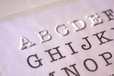 Make movable letters using puff paint on waxed paper over a typed sheet.  Let dry, peel off, spelling wars, commence!