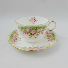 Gorgeous tea cup made by Aynsley. Pretty pink flowers on the tea cup and saucer. Gold trimming on cup and saucer edges. Excellent condition (see photos). Markings read: Aynsley England Bone China For more Aynsley tea cups, please click here: