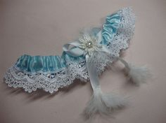 Beautiful blue Lace garter Wedding/Prom garter with feather by Hoalanebridal, #weddings #brides #prom