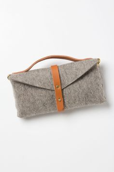 Riveted Felt Bike Bag - Anthropologie.com |   Inside Brooklyn's Flux Productions studio, artist Ryan Greer plays with elements like weathered denim, supple leather and scruffy wool to create handcrafted accessories that exude sophistication. Industrial yet warm, soft but sturdy, this bike pannier combines wool felt with handsome brass details and fine leather straps fit for the urban traveler.