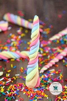 DIY Edible Unicorn Horns are a fun nerdy treat that are perfect for any unicorn themed party! They are sweet and colorful and fun!