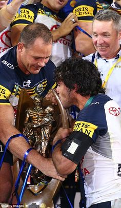 Thurston seals his team's win with a kiss on the premiership trophy Johnathan Thurston, Rugby Pictures, National Rugby League, Cowboys Win, Brisbane Broncos, Queenslander, Great Team, Replay, Soccer Players