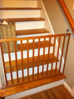 old crib rail repurposed as a baby gate- great for dog gate