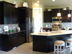Kitchen layout idea..love the dark cabinets--- LOOK BABE sinks in the middle are totally normal!