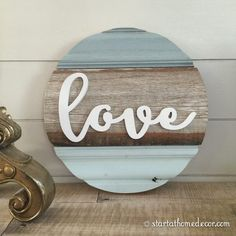Start at Home Decor's New Line of Reclaimed Wood rounds with a love Word cutout.
