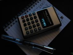 calculator, pen and notepad