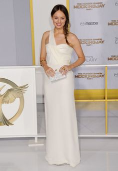 Laura Haddock.. white one-shoulder Burberry dress, Edie Parker Jean clutch, and Hannah Warner jewels..