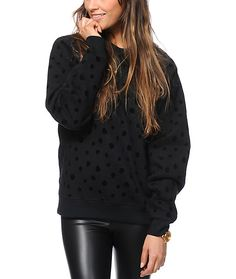 Made with a thick construction and a soft fleece lining, this crew neck sweatshirt has soft velvety polka dots throughout for a premium look and superior comfort.
