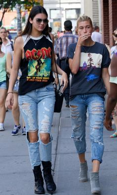 Kendall Jenner Street Style: See Her 20 Best Looks - Vintage ACDC cut-off t-shirt styled with ripped + distressed denim, aviators, and lace up boots