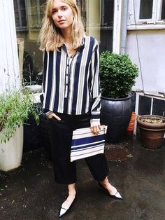 For a relaxed evening outfit, style a striped blouse with fitted trousers and pointy-toe flats. // #StreetStyle #Fashion