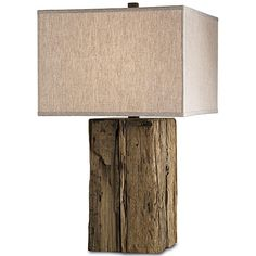 Urban rustic, farm chic, rough luxe; whatever you want to call it, this lamp is all about using repurposed materials and showing the touch of human hands. $575