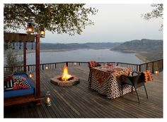 Singita Pamushana Lodge ★★★★★ Malilangwe Wildlife Reserve, Zimbabwe - dusk on the deck Most Romantic Places, Outdoor Tables, Outdoor Decor, Victoria Falls, Africa Travel, Traveling By Yourself, Safari, Cool Photos, National Parks
