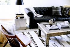 Home Tour: A Perfectly Balanced Creative Seattle Pad//Chesterfield sofa with kilim rug and carved coffee table
