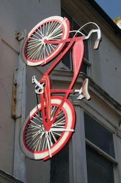Hand painted giant bicycle for a shop in Brighton by paul harrison