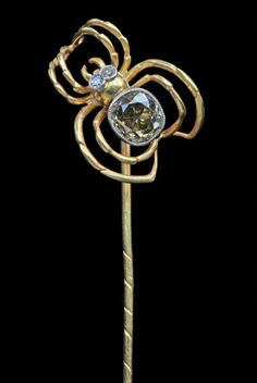 "This Art Nouveau stick pin spider is gold, with a .80 carat diamond body. He's European, circa 1900. (Note: The Tadema Gallery website does not directly link to items, so click on ""Cufflinks & Stickpins,"" and you'll see him.)"