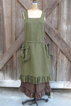 linen jumper pinafore apron dress tunic in dark olive green. $139.00, via Etsy.