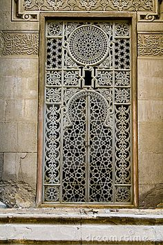 Large window with lots of work and artistic details, located in one of the old mosques in Cairo Egypt.