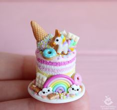 Miniature Unicorn and rainbow cake. Food for dolls Gâteau miniature licorne et … Polymer Clay Cake, Polymer Clay Kawaii, Polymer Clay Ornaments, Polymer Clay Animals, Polymer Clay Miniatures, Polymer Clay Necklace, Polymer Clay Flowers, Polymer Clay Creations, Polymer Clay Beads