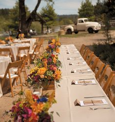 Brides: Elizabeth and Sean in Los Gatos, CA. On the tables, vibrant arrangements of dahlias, roses, and sunflowers, designed by florist The Wild Geranium, popped against linens, place cards, and thank-you notes in muted hues. Rentals were provided by A Party Place.