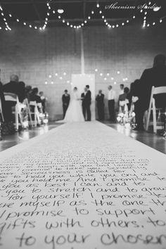 Love letters handwritten on an aisle runner. A Modern, Industrial, Canadian Wedding | Photography by Sheenism Studios